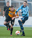 "Alloa""s Calum Gallagher gets away from Forfar's Michael Bolochoweckyj."