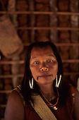 A-Ukre Village, Xingu, Brazil. Irepa, a Kayapo woman in her house wearing bead earrings.