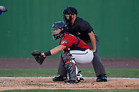 Potomac Nationals catcher Jakson Reetz (1) and umpire Josh Gilreath during a Carolina League game against the Myrtle Beach Pelicans on August 14, 2019 at Northwest Federal Field at Pfitzner Stadium in Woodbridge, Virginia.  Potomac defeated Myrtle Beach 7-0.  (Mike Janes/Four Seam Images)