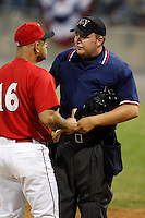 June 19, 2009:  Manager Mark DeJohn of the Batavia Muckdogs argues a call by home plate umpire Matt Jones during a game at Dwyer Stadium in Batavia, NY.  The call, a hit by pitch, was over turned when Jones asked field umpire Nick Mahrley for help.  The Muckdogs are the NY-Penn League Short-Season Class-A affiliate of the St. Louis Cardinals.  Photo by:  Mike Janes/Four Seam Images
