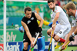 The Hague, Netherlands, June 08: Martin Zwicker #20 of Germany tries to block a shot by Shea McAleese #25 of New Zealand during the field hockey group match (Men - Group B) between the Black Sticks of New Zealand and Germany on June 8, 2014 during the World Cup 2014 at Kyocera Stadium in The Hague, Netherlands. Final score 3-5 (1-3) (Photo by Dirk Markgraf / www.265-images.com) *** Local caption ***