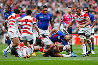 Samoa Outside Centre Paul Perez is tackled - Mandatory byline: Rogan Thomson - 03/10/2015 - RUGBY UNION - Stadium:mk - Milton Keynes, England - Samoa v Japan - Rugby World Cup 2015 Pool B.