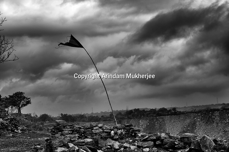 A marker is erected to warn locals about the landslide zone caused by mine fire in Jharia, Jharkhand, India