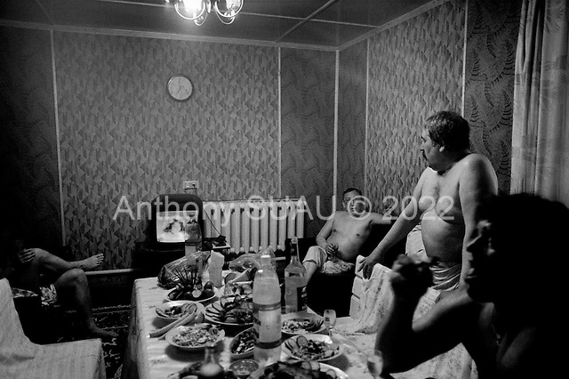 Aldan, Yakutia, Russia .May-June 1997.The private owners of a gold company enjoy a relaxing evening in their private company sauna..