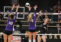 Maddie Lee (23) of Bentonville spikes ball against Sophie Snodgrass (10) and Kennedy Phelan (2) of Fayetteville on Thursday, Oct.  7, 2021, during play at Tiger Arena in Bentonville. Visit nwaonline.com/211008Daily/ for today's photo gallery.<br /> (Special to the NWA Democrat-Gazette/David Beach)