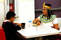 """Marc Hayot/Siloam Sunday. Angel """"Harry Potter"""" Martinez talks to his mother Joanna """"Cleopatra"""" Martinez about life at Hogwarts at the Boys and Girls Club Halloween party."""