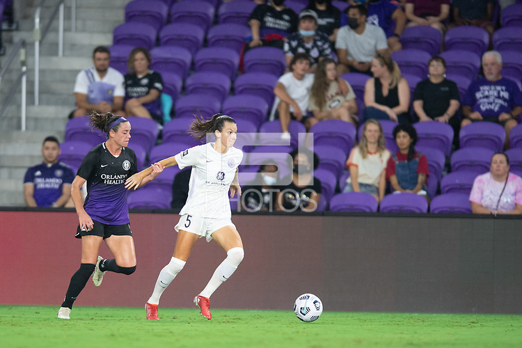 ORLANDO, FL - SEPTEMBER 11: Cece Kizer #5 of Racing Louisville FC dribbles the ball during a game between Racing Louisville FC and Orlando Pride at Exploria Stadium on September 11, 2021 in Orlando, Florida.