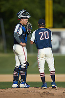 High Point-Thomasville HiToms catcher Rudy Maxwell (25) (Duke) has a meeting on the mound with pitcher Jacob Edwards (20) (UNC Asheville) during the game against the Deep River Muddogs at Finch Field on June 27, 2020 in Thomasville, NC.  The HiToms defeated the Muddogs 11-2. (Brian Westerholt/Four Seam Images)