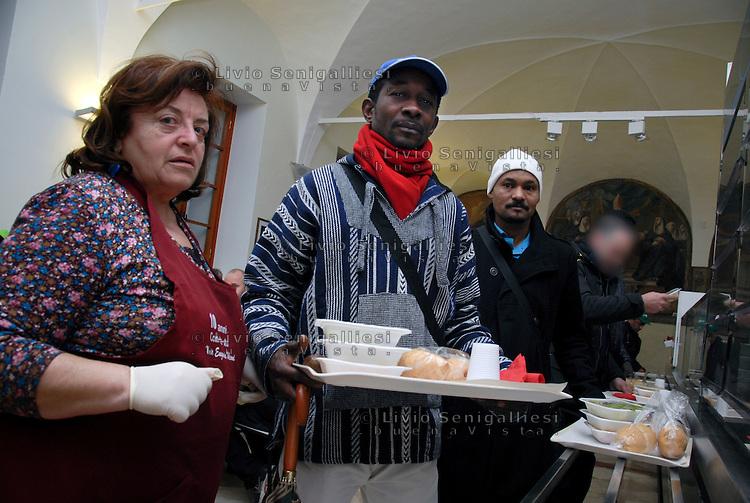 Brescia / Italia 2014<br /> Immigrati senza casa ricevono un pasto caldo presso le cucine della Caritas diocesana, nei pressi della stazione ferroviaria.<br /> Immigrants homeless receive a hot meal at the kitchens of Caritas, near the train station. <br /> Photo by Livio Senigalliesi