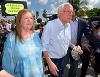 HOMESTEAD, FLORIDA - JUNE 27: Democratic presidential hopeful Bernie Sanders, Jane O'Meara Sanders stands on a ladder as he looks into the facility holding migrant children in front of a detention center. The controversial for-profit detention center holds around 2,300 children from the ages of 13 to 17, who have been placed in the care of the Department of Health and Human Services after being detained at the border on June 27, 2019.on June 26, 2019 in Homestead Florida<br /> <br /> <br /> People:  Bernie Sanders, Jane O'Meara Sanders