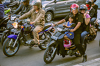 Yogyakarta, Java, Indonesia.  Family on Motorbike, Jl. Laksda Adisucipto Street.