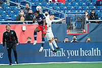FOXBOROUGH, MA - MAY 1: DeJuan Jones #24 of New England Revolution and Brooks Lennon #11 Midfielder of Atlanta United FC compete for a high ball during a game between Atlanta United FC and New England Revolution at Gillette Stadium on May 1, 2021 in Foxborough, Massachusetts.