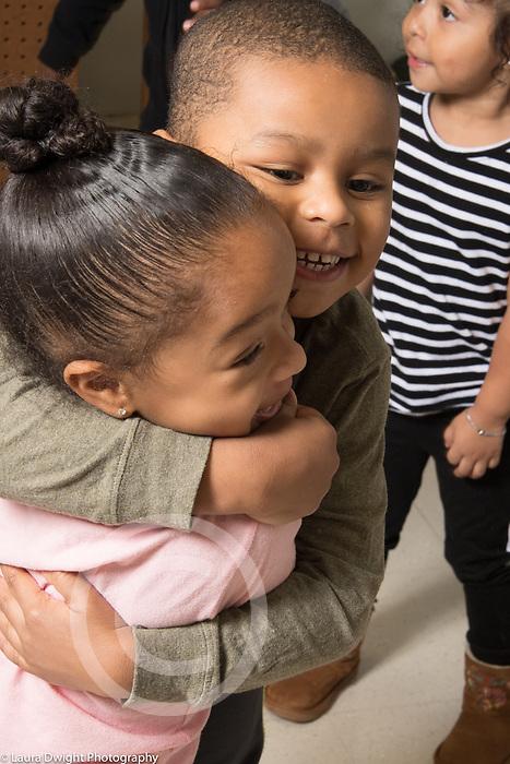 Education Preschool 3 year olds boy and girl hugging