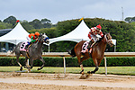 HOT SPRINGS, AR - APRIL 13:  Apple Blossom Handicap at Oaklawn Park on April 13, 2018 in Hot Springs,Arkansas.  #2 Unbridled Mo with jockey Ricardo Santana and #5 Unique Bella with jockey Mike E. Smith. . (Photo by Ted McClenning/Eclipse Sportswire/Getty Images)