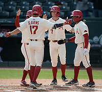 Arkansas first baseman Brady Slavens (17) is congratulated at the plate Wednesday, April 7, 2021, by second baseman Robert Moore, right fielder Cayden Wallace (7) and center fielder Christian Franklin after hitting a three-run home run scoring Moore and Franklin during the first inning of the Razorbacks' 10-3 win over UALR at Baum-Walker Stadium in Fayetteville. Visit nwaonline.com/210408Daily/ for today's photo gallery. <br /> (NWA Democrat-Gazette/Andy Shupe)
