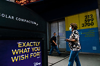 NEW YORK, NY - AUGUST 8: People walk next to a poster of a retail space to rent in Times Square on August 8, 2020 in New York City. With more than four months NYC has closed some of their doors to combat the coronavirus, putting its vital tourism industry paralyzed with a moribund economy, where business and leaders are trying to revive an industry that brought in $45 billion annually and supported more than 300,000 jobs. (Photo by Eduardo MunozAlvarez/VIEWpress)