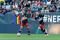 FOXBOROUGH, MA - JUNE 23: Tommy McNamara #26 of New England Revolution dribbles at midfield during a game between New York Red Bulls and New England Revolution at Gillette Stadium on June 23, 2021 in Foxborough, Massachusetts.