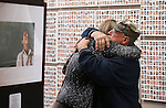Amy Roby, project manager of the Always Lost: A Meditation on War exhibit, hugs Vietnam Veteran Bruce Bertram at the Legislative Building in Carson City, Nev., on Monday, April 6, 2015. <br />