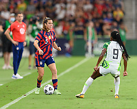 AUSTIN, TX - JUNE 16: Kelley O'Hara #5 of the United States attempts to dribble the ball around Toni Payne #9 of Nigeria during a game between Nigeria and USWNT at Q2 Stadium on June 16, 2021 in Austin, Texas.
