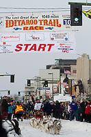2010 Iditarod Ceremonial Start in Anchorage Alaska musher # 29 KAREN RAMSTEAD with Iditarider KELLUS STONE