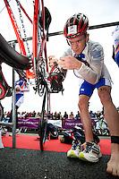 17 SEP 2011 - LA BAULE, FRA - Matt Sharp (Mulhouse Olympique Tri) prepares his bike before the start of the final round of the men's French Grand Prix Series at the Triathlon Audencia in La Baule, France (PHOTO (C) NIGEL FARROW)