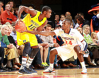 CHARLOTTESVILLE, VA- NOVEMBER 29: Tim Hardaway Jr. #10 of the Michigan Wolverines is defended by K.T. Harrell #24 of the Virginia Cavaliers during the game on November 29, 2011 at the John Paul Jones Arena in Charlottesville, Virginia. Virginia defeated Michigan 70-58. (Photo by Andrew Shurtleff/Getty Images) *** Local Caption *** Tim Hardaway Jr.;K.T. Harrell