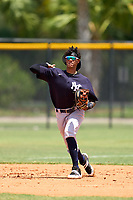 FCL Yankees shortstop Alexander Vargas (14) throws to first base during a game against the FCL Tigers on June 28, 2021 at Tigertown in Lakeland, Florida.  (Mike Janes/Four Seam Images)