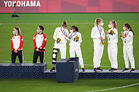 YOKOHAMA, JAPAN - AUGUST 6: Alyssa Naeher #1 of the United States talks with Crystal Dunn #2 of the United States during the 2020 Tokyo Olympics Women's Soccer medal ceremony at International Stadium Yokohama on August 6, 2021 in Yokohama, Japan.