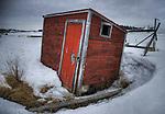 small fish shack in winter.