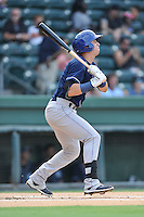 Catcher Dom Nunez (9) of the Asheville Tourists bats in a game against the Greenville Drive on Thursday, August 13, 2015, at Fluor Field at the West End in Greenville, South Carolina. Asheville won, 8-1. (Tom Priddy/Four Seam Images)