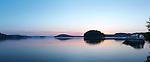 Peaceful panoramic sunrise nature scenery of a boat at Mary Lake, Port Sydney, Muskoka, Ontario, Canada.