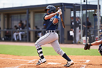 FCL Tigers East catcher Sergio Tapia (18) bats during a game against the FCL Yankees on July 27, 2021 at the Yankees Minor League Complex in Tampa, Florida. (Mike Janes/Four Seam Images)