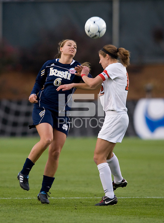 Lauren Beachy (12) of Ohio State heads the ball away from Melissa Henderson (6) of Notre Dame during the first game of the NCAA Women's College Cup at WakeMed Soccer Park in Cary, NC.  Notre Dame defeated Ohio State, 1-0.