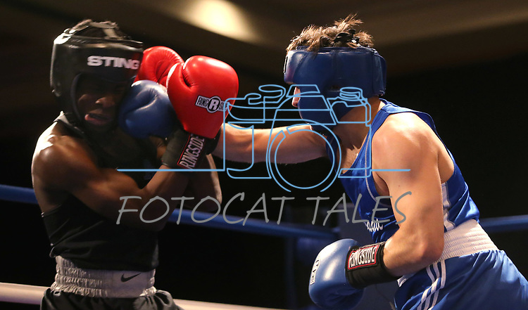 Nevada boxer Dillon Maguin and Air Force Academy boxer Ife Origbanjo compete in the National Collegiate Boxing Association action in Reno, Nev. on Friday, Jan. 31, 2020. Maguin won the bout. <br /> Photo by Cathleen Allison