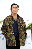 """CANNES, FRANCE - JULY 13: Director Justin Chon attends the """"Blue Bayou"""" photocall during the 74th annual Cannes Film Festival on July 13, 2021 in Cannes, France. <br /> CAP/GOL<br /> ©GOL/Capital Pictures"""