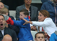 Kai Rooney fights with his brother Klay as   Mum Coleen  trys to break it up