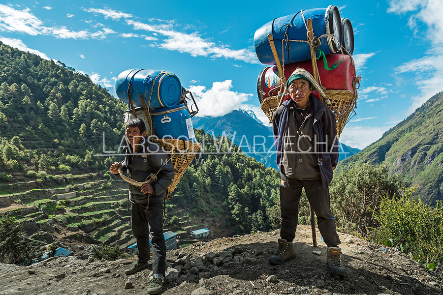 Portrait of (Left) Senta Tamang 45 years old from Phaflu region and<br /> (Right) Sonam Sherpa, 42 years old from Phaflu region. carrying expedition equipment from Everest Basecamp to Lukla and then to Kathmandu, seven (7) days journey which will earn them a double payment for carrying double load. Khumbu, Nepal