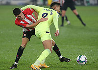Christian Norgaard of Brentford tackles Newcastle's Joelinton during Brentford vs Newcastle United, Carabao Cup Football at the Brentford Community Stadium on 22nd December 2020