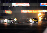 May 18, 2012; Topeka, KS, USA: NHRA funny car driver Jeff Arend (right) races alongside Jack Beckman during qualifying for the Summer Nationals at Heartland Park Topeka. Mandatory Credit: Mark J. Rebilas-
