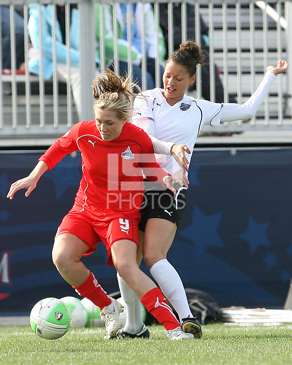 Allie Long #9 of the Washington Freedom shields the ball from Estelle Johnson #24 of the Philadelphia Independence during a WPS pre season match at the Maryland Soccerplex on March 27 2010 in Boyds, Maryland. The game ended in a 0-0 tie.