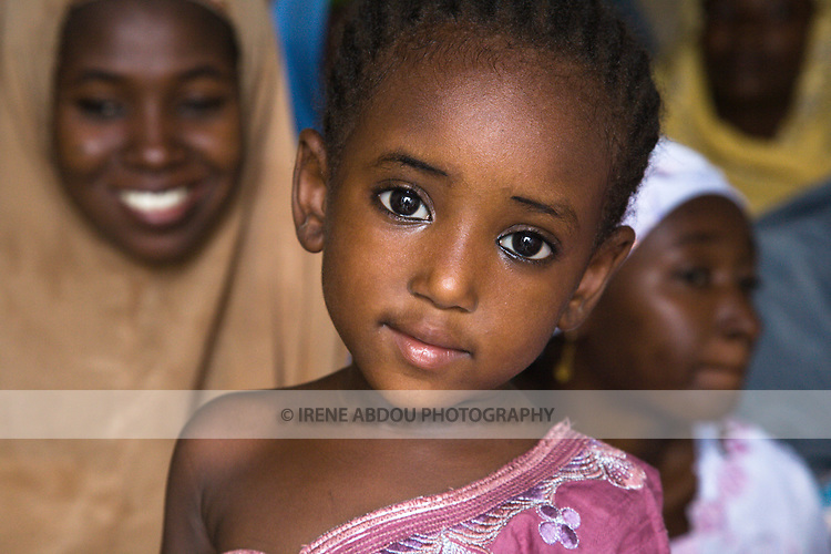 A child in the Tudun-Murtala area of Kano, Nigeria wears the tradtional Muslim garb of the Hausa ethnic group.