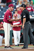 Florida State Seminoles head coach Mike Martin (11) talks with the umpire before Game 2 of the NCAA College World Series against the Arkansas Razorbacks on June 15, 2019 at TD Ameritrade Park in Omaha, Nebraska. Florida State defeated Arkansas 1-0. (Andrew Woolley/Four Seam Images)
