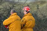 Search and rescue team heading to the scene of the mid air collision over Kenfig sand dunes near Porthcawl..