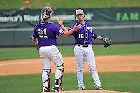 Closer Colton Davis (16) of Western Carolina celebrates with catcher Danny Bermudez (21) after beating Mercer 4-2 in Game 1 of the SoCon Tournament championship final series on Sunday, May 29, 2016, at Fluor Field at the West End in Greenville, South Carolina. (Tom Priddy/Four Seam Images)