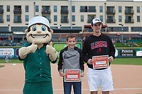Fort Wayne TinCaps mascot Johnny TinCap presents Jeremiah Troyer and Tyler Scholfield with their 2019 All-Star Reader Program awards before a Midwest League game between the Kane County Cougars and Fort Wayne TinCaps at Parkview Field on May 1, 2019 in Fort Wayne, Indiana. Fort Wayne defeated Kane County 10-4. (Zachary Lucy/Four Seam Images)