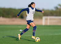 ORLANDO, FL - JANUARY 21: Alana Cook #28 of the USWNT dribbles during a training session at the practice fields on January 21, 2021 in Orlando, Florida.