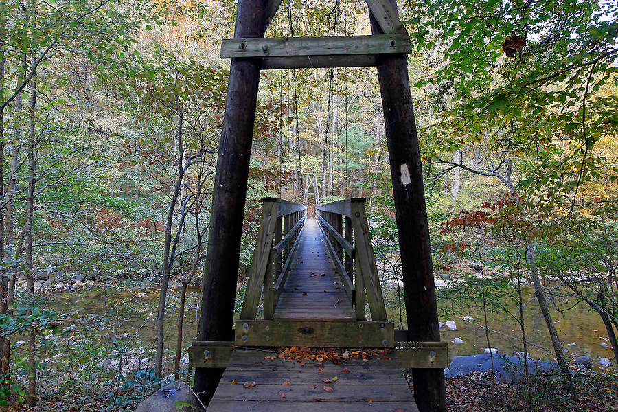 A suspension bridge crosses the Tye River near the Priest and Three Ridges mountains in Nelson County, Va. Photo/Andrew Shurtleff