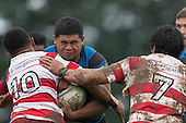 Vuga Tagicakibau and Jamie Gilbert-Clark try to stop Filipe Pau's run. Counties Manukau Premier Club Rugby game between Karaka and Onewhero, played at Karaka on Saturday June 25th 2016. Karaka won the game 15 - 10 after leading 10 - 3 at halftime.<br />  Photo by Richard Sprnger.