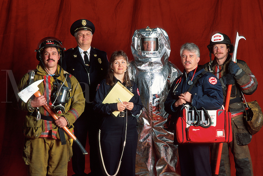 Group portrait of  fire fighters in a variety of on the job uniforms.