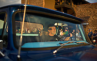 """Rudy Dutson and his dog drive down Cedar Avenue in Sandpoint, ID during the 25th 'Lost in the Fifties' weekend parade. """"It's a '65 Chevy,"""" said Dutson as he passed. """"This is my sixth year driving in the parade."""".. (©Matt Mills McKnight/2010)"""